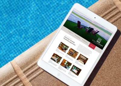 Birch Lodge website on an iPad poolside